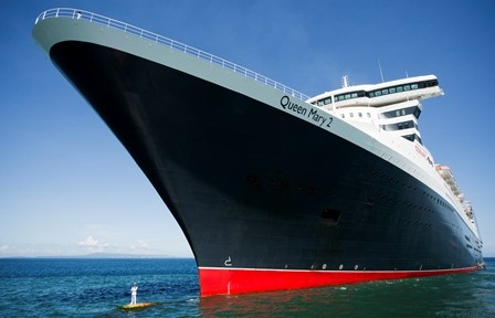 Queen Mary 2 Captain Stands on Ships Bulbous Bow